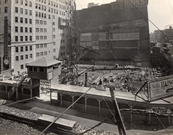 A May 1925 photo illustrating the beginning stages of construction. A few buildings were razed to make room for the Illinois Building, including the Jean Hat Shop, Rent-A-Ford office, the Leo Krauss jewelry store, and Mr. Smith's motion picture theater. The Illinois Building neighbored Rink's, pictured here.