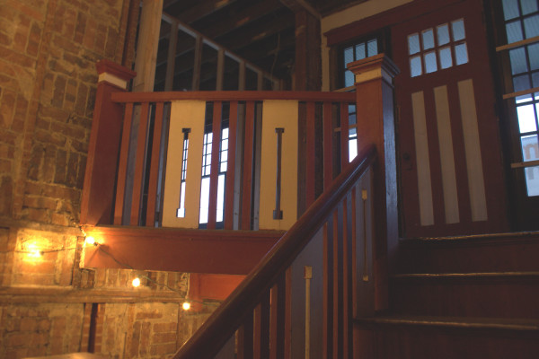 The original stairwell will remain intact, and will be included within the north condo. The north condo will have access to the second-floor balcony through the door pictured. (photo by Dawn Olsen)