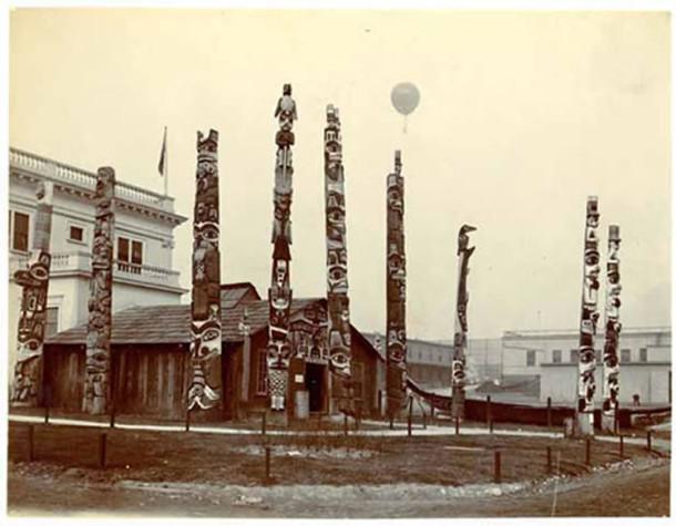 Totem poles surround the Esquimau Village at the St. Louis World's Fair