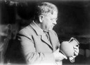 George A. Reisner examining a ceramic vessel March 29, 1929 (Giza Archives Project A6721)