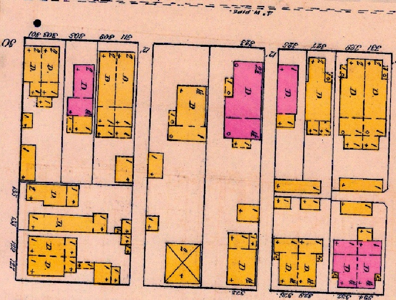 The 1887 Sanborn Map labels what is now listed as 619 E. New York St. as 323 E. New York St. The dwelling just to the west is a single-family home, but the address is not specified. This home was later razed in order to make room for a double, which appears in later Sanborn Maps.