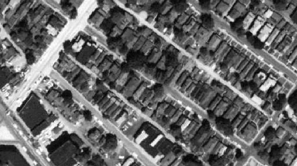 A 1962 aerial image of the North Square area, before homes were demolished to make room for the Interstate.