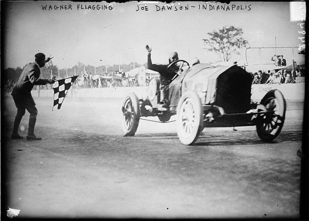 Joe Dawson crossing the finish line of the 1912 Indy 500 - photo from Wikipedia