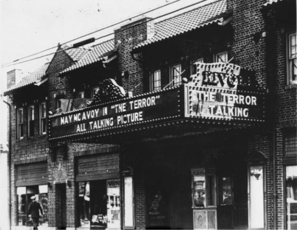 "The Rivoli Theater, as seen in the late 1920s. The Rivoli, located at 3155 E. 10th St., was constructed in 1927. Here, the marquee advertises ""The Terror,"" a 1928 ""all-talking"" film starring May McAvoy. (photo courtesy Bass Photo Co. Collection, Indiana Historical Society)"