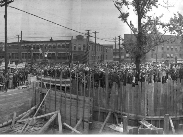 Cornerstone ceremony at Manual Training High School, Madison Flats in back right, 1920, Photograph by Charles Bretzman, Indiana Historical Society