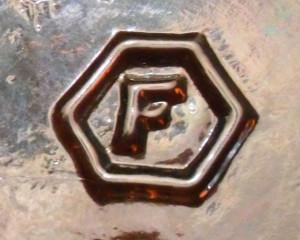 Fairmount Glass Company's bottle mark (photo courtesy of www.glassbottlemarks.com)