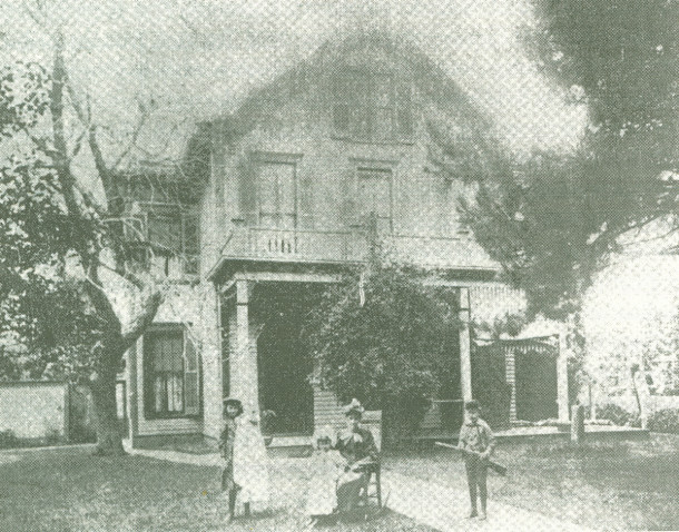 Photo of Nora, Emily, Florence, and Tom Taggart in front of 410 N. Tennessee circa 1891 (image from biography, Thomas Taggart by James Philip Fadely)