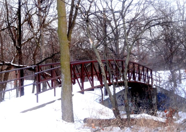 The bridge spanning Pleasant Run creek connects Ellenberger Park with the Pleasant Run Parkway