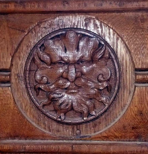 The interior trim corner blocks feature carved mythical faces. (Courtesy of David Hedrick)