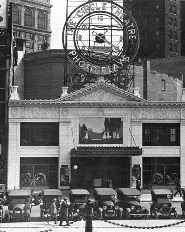 "The Circle Theater appears much as it does today with the exception of the massive clock advertising ""photo plays."""