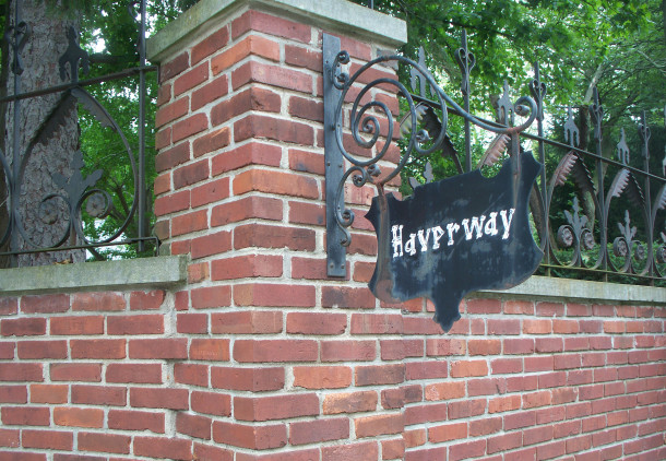 Handpainted metal sign at the entry to the property dates to the days of the farmhouse (photo by Sharon Butsch Freeland)
