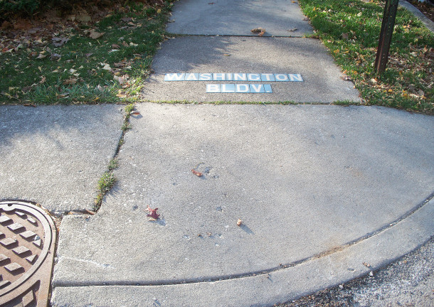 An example of a street name embedded in the sidewalk still exists on the corner of E. 43rd and Washington Boulevard (photo by Sharon Butsch Freeland)