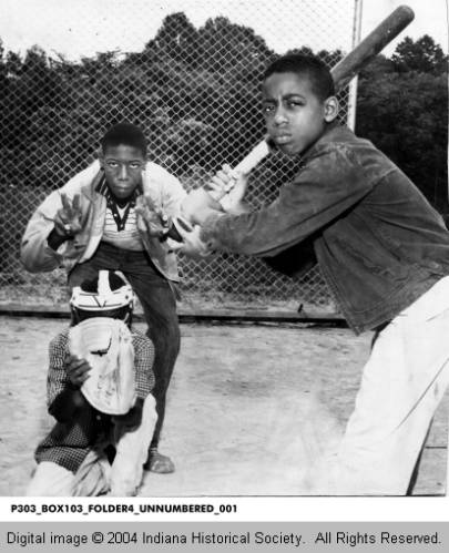 This 1960 photograph from The Indianapolis Recorder depicts two young men playing baseball at a local PAL Club