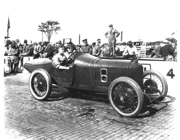 1916 Johnny Aitken at wheel of a Peugeot