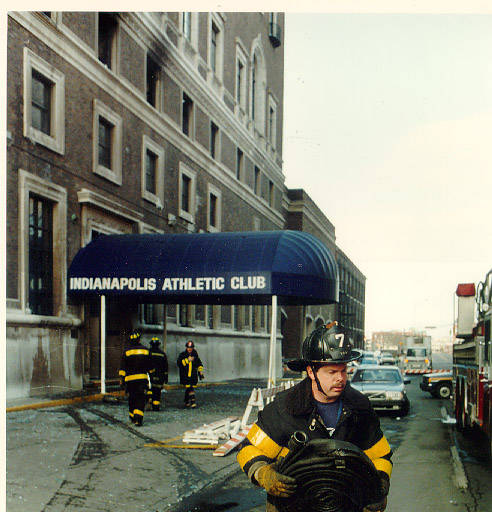 An Indianapolis Fireman cleans up the aftermath of a fire at the Indianapolis Athletic Club that left three people dead (Courtesy Indianapolis-Marion County Library)