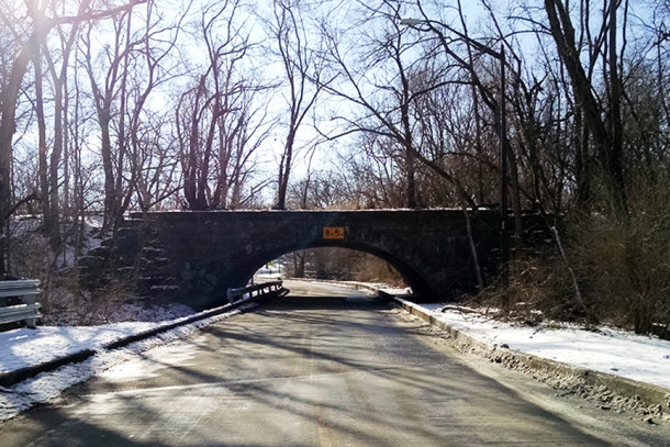 View of the Pleasant Run Parkway railroad bridge and vehicle underpass, from the northeast side of the stone structure   (2016 photo by Sharon Butsch Freeland)