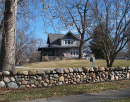 Bungalow on three lots has attractive river rock wall  (2016 photo by Sharon Butsch Freeland)