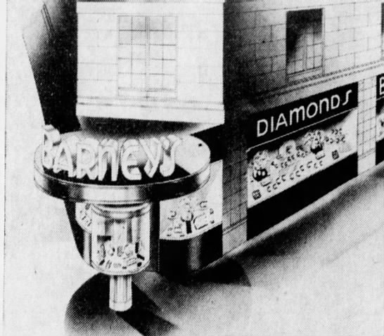 An opening day ad showcased a rendering of the unique sign and display case fronting Barney's (Courtesy Indiana State Library)