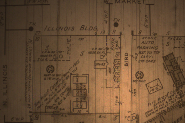The 1915 Sanborn map (updated to the 1940s) illustrates the many fine amenities of the Illinois Building. The four elevators are seen to the right of the building. A parking garage is also labeled. Automatic sprinklers were also present in the building (though only on the lower levels), as was air conditioning.