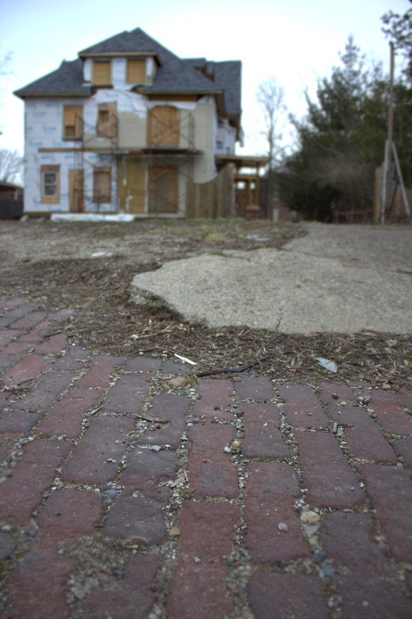 The back of the property, as seen in March 2013. The original brick in the alleyway is visible, but 2110 College Ave. has never had a carriage house or garage. (photo by Dawn Olsen)