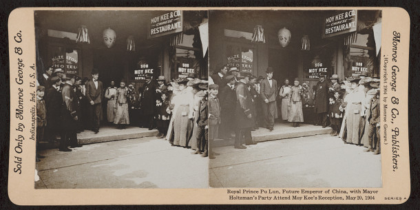 Prince Pu Lun holds flowers at the entrance of Moy Kee's Chinese Restaurant. Stereograph by Monroe George courtesy of the Library of Congress, Stereograph Collection