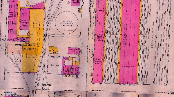 "The 1898 Sanborn Map scales the large Cleveland, Cincinnati, and Chicago Railroad Depot against 336 S. Delaware. (One residential home, as well as the carriage house, have been demolished.) Furthermore, the Map labels the Indianapolis Gas Company with ""Buildings All Vacant & In Bad Repair."")"