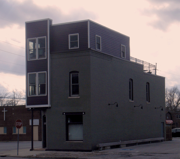 This building, featured by Luke Kessler and Michael C. Painton on May 2, 2012, shows that a reasonably modern addition has been added to this historic building, located on East 16th Street.