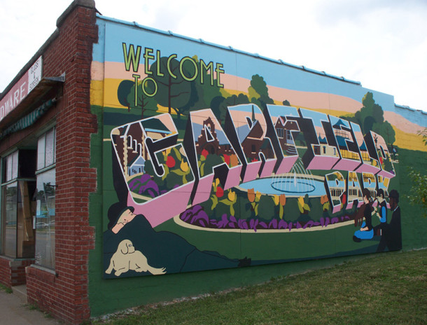 A colorful postcard-like mural on the north side of Suding's Hardware building welcomes people to the Garfield Park area (photo by Sharon Butsch Freeland)