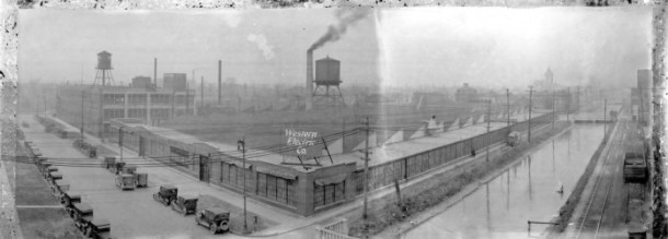 In 1920, a Western Electric Plant occupied the current Eugene and Marilyn Glick History Center at 450 West Ohio Street.  The canal is on the right, and a railroad track, which is no longer there, is on the east bank of the canal.  The New York Street bridge crosses the canal in the distance.