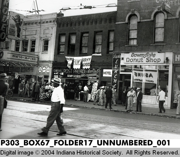 Businesses on Illinois St. near the intersection of Indiana Ave. and Ohio St. The Rodeo Theatre is on the left side of the photo. (Indianapolis Recorder Collection, Indiana Historical Society).