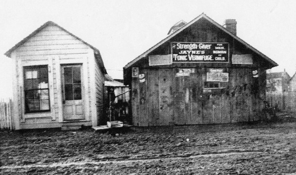 The darker building was a blacksmith shop adjacent to the General Store that no longer stands. A copy of Samuel Kerr's blacksmith journal, 1848, reveals that he lived with Hiram Bacon & his wife for several years.