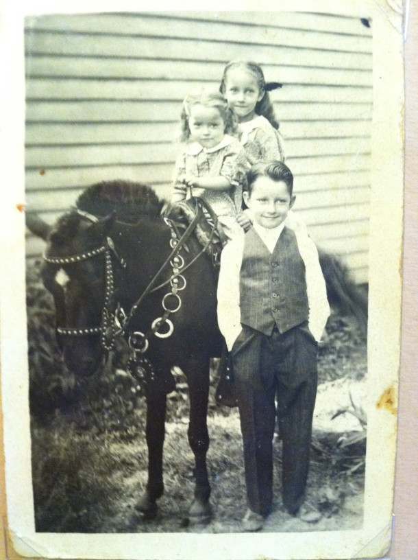 Ruth (in back) with two siblings. Courtesy of Ruth Shaw.