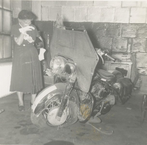 Edward's motorcycle after the crash. His mother, Cora Berry, stands beside it in horror. Courtesy of Brigette Cook Jones.