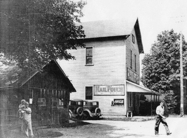 "Toward the end of its ""hay day,"" the Steinmeier general store and Millersville blacksmith shop (darker building to the left)"