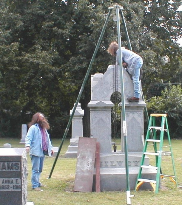 Heavy restoration: Larger monuments sink due to their weight and the fact that the wood coffin below collapses, over time. Many of the major Fall Creek Cemetery monuments had to be lifted and reset to form a more permanent support -- some requiring several days of work.