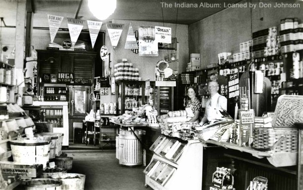 Interior of Dickey's Market, clerks Helen Smith and Frank Dickey (Marshall's brother), 25 April 1938 (The Indiana Album: Loaned by Don Johnson)