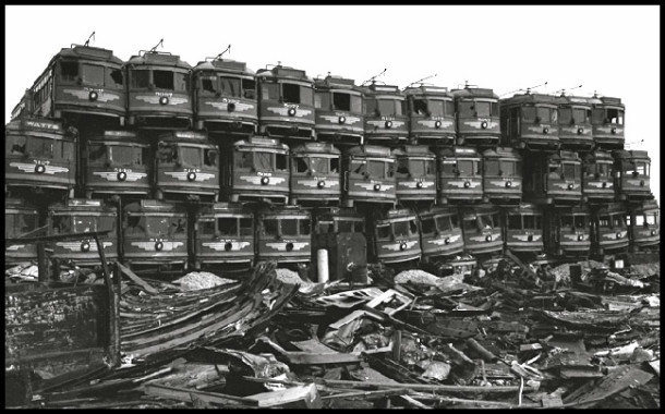 Stacks of Pacific Electric Redcars await scrapping in Los Angeles circa 1956