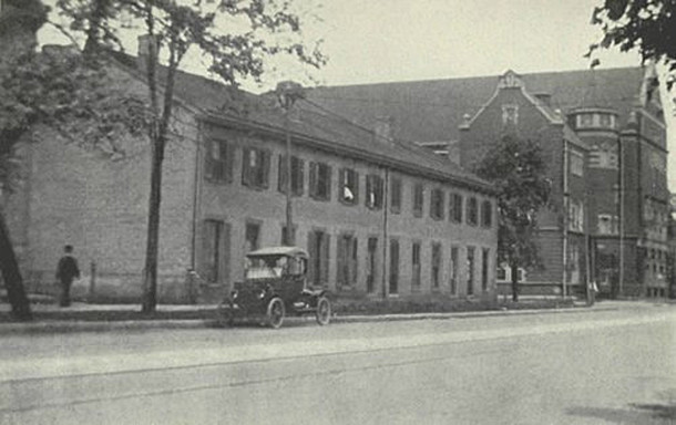 Brick townhouses erected in 1851 by Jacob Vandegrift near Illinois and Michigan , as they appeared in the early 1900s (photo from Fanny Stevenson biography by Nellie Vandegrift Sanchez)