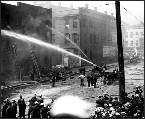 Firefighters battle the blaze from the Prest-O-Lite blast that helped drive St. Vincent's north - Photo: courtesy of the Indiana Historical Society