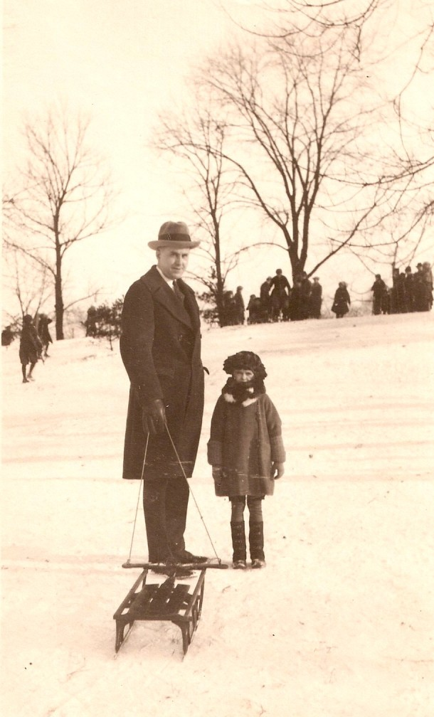 William Schneider, who spent many years working for Marion County and the City of Indianapolis, is seen pulling a sled with his young daughter, Evelyn. (Photo credit to vintageirvington.blogspot.com)