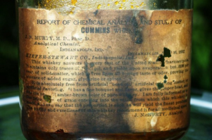 "An 1892 bottle of sour mash whiskey distributed by the Kiefer-Stewart Company displays the results of a chemical analysis performed by J.N. Hurty, a pharmacist/M.D. who served as State Health Commissioner from 1896 through 1922. On the label, Hurty proclaims that the ""purity and excellence"" of the sour mash whiskey recommended it ""for all medicinal purposes."" Photo: Libby Cierzniak."
