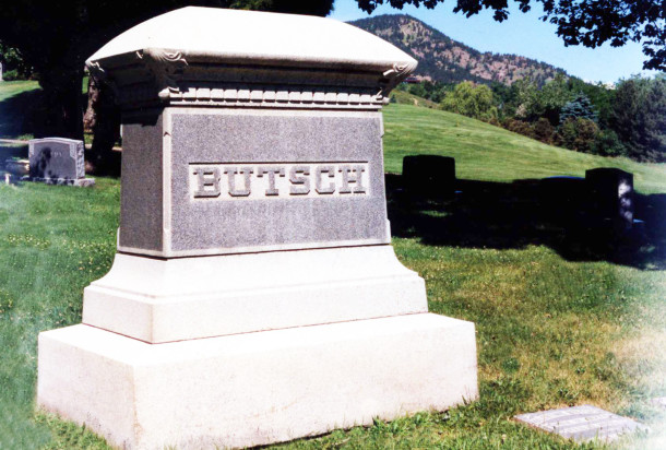 Butsch family monument surrounded by individual headstones in Green Mountain Cemetery in Boulder, Colorado (photo by Brough Stewart)