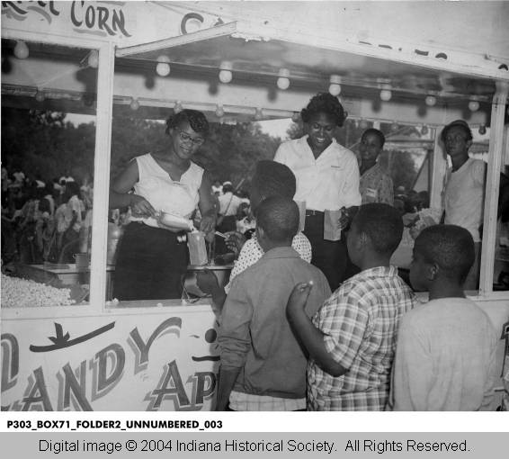 Children waiting in line for popcorn at the Indianapolis recorder picnic in 1957. Image: courtesy The Indiana Historical Society