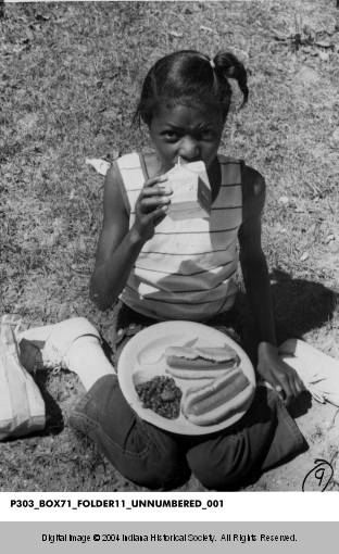 Annette Robinson enjoying a meal at the Indianapolis Recorder picnic. Image: courtesy The Indiana Historical Society