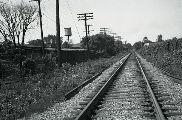 View of the Monon Railroad tracks looking north from 52nd Street with Lux Laundry water toweer in the distance (photo courtesy of monon.org)