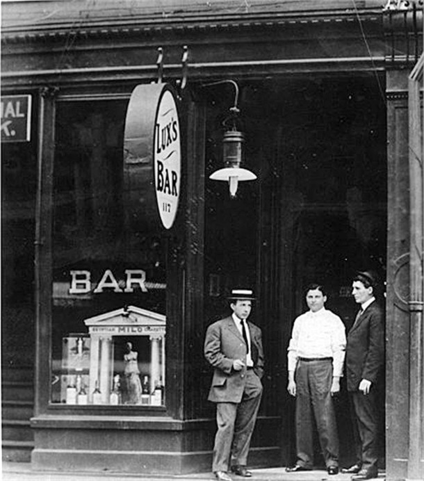 Tony Lux (far right) and two unidentified men standing outside Lux's Bar at 117 West Washington Street (image courtesy ancestry.com)