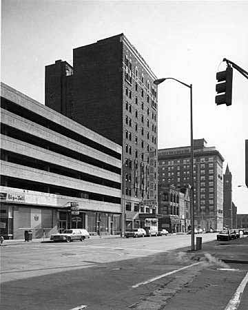 View looking south on Illinois from Maryland Street, 1983. Shown is the parking garage that replaced the Grand Hotel, the Warren Hotel (today the Cantebury Hotel), St. Elmo's Steak House, the Severin Hotel, and Union Station. (Indiana Historica Society, William H. Bass Photo Company, #334615-3)