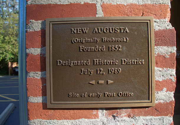 Plaque on the side of the former Oddfellows Building (2014 photo by Sharon Butsch Freeland)