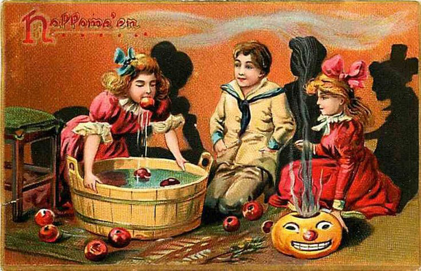 Postcard illustrates apple-bobbing (image courtesy of ebay)