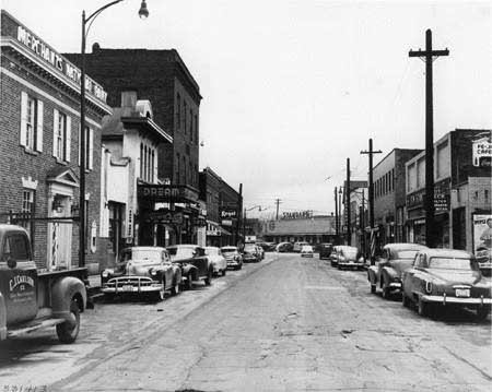 Circa 1940s view looking south on Station Street. The Brightwood Hall is the tallest brick building on the left. (Indiana Historical Society)